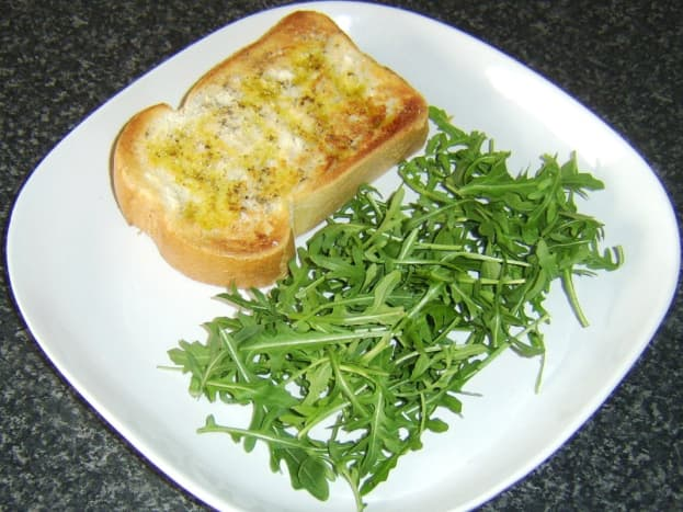 Toast and salad are plated first