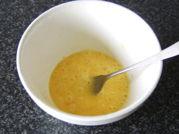Beating duck eggs for omelette