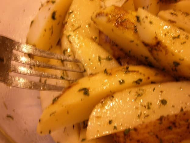 Baked french fries with rosemary and parsley. I toss slices of potatoes with dried rosemary, parsley, sea salt, pepper and some olive oil. Healthy and delicious.