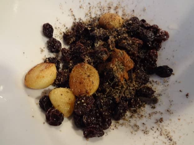 Toast the nuts, seeds, raisins, garlic, etc.