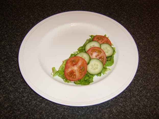 Salad is prepared and plated before omelette is started