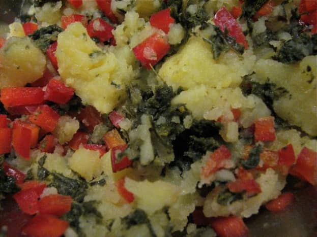 Smashed potatoes, red bell pepper, chili flakes and minced kale from a jar.