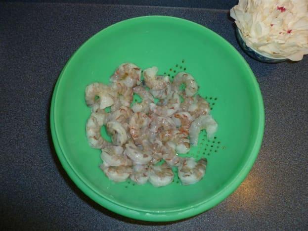 Devein and rinse shrimp.