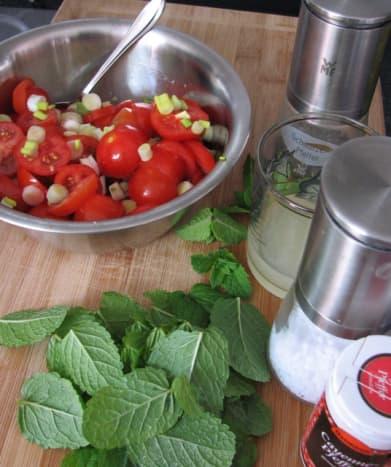 Preparing the lemon-mint dressing, with cayenne pepper!