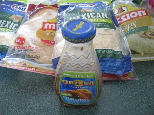Ingredients: taco sauce, shredded Mexican cheese, wraps.