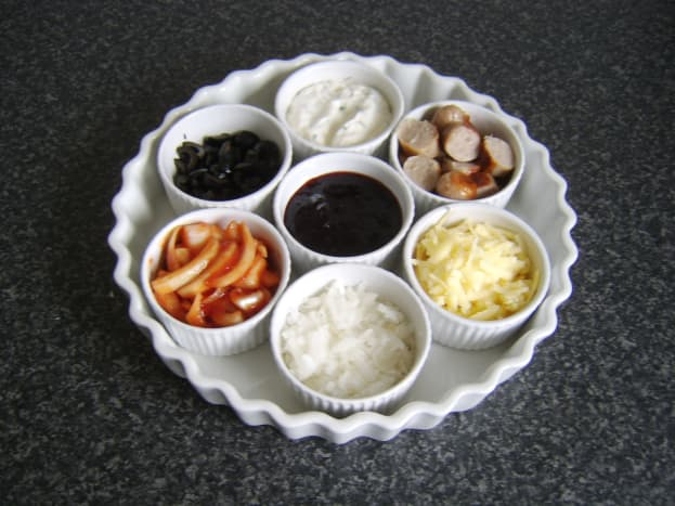 Ramekins are assembled on a serving tray or dish.