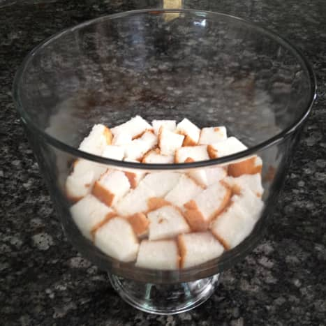 1. Fill the bottom of a trifle bowl with cubed angel food cake.