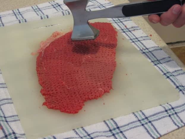 Pound the steak with a tenderizer.