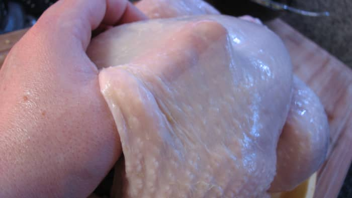 Loosen the chicken skin carefully - slide a finger or a spoon and gently pull it away from the meat.