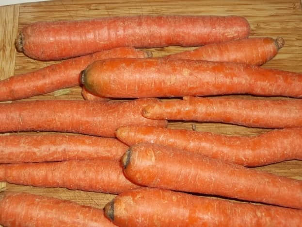 Carrots ready to be peeled and shredded.
