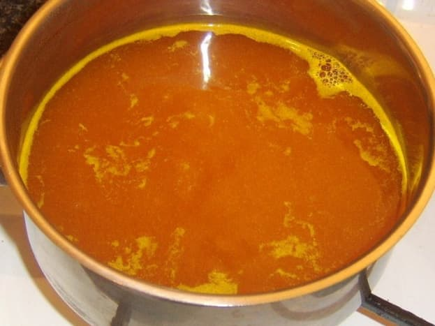 Turmeric and salt are added to the boiling water for the rice