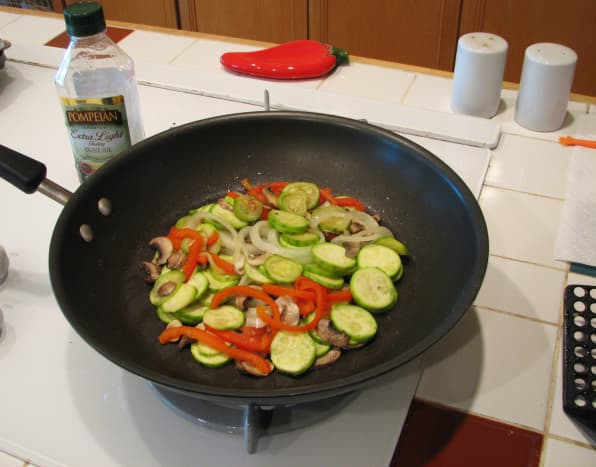 Saute the topping mixture in olive oil