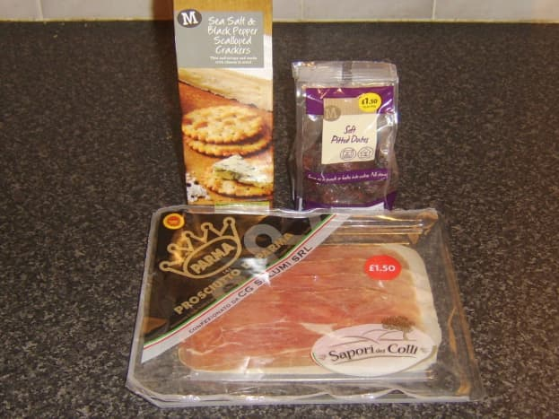Salt and pepper crackers, dried dates and Parma ham
