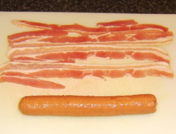 Preparing to assemble bacon dog