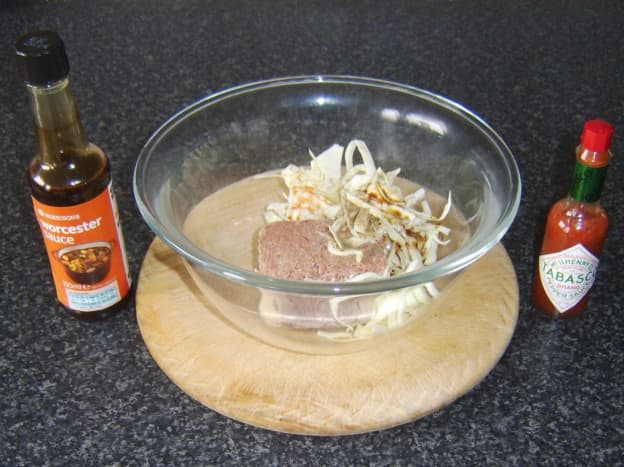 Mixing ingredients for corned beef and cabbage pasty filling