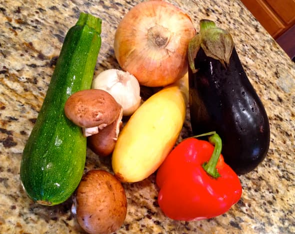 Choose a variety of vegetables to roast. Chop vegetables and garlic.