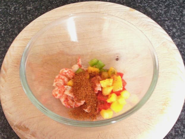 Combining crayfish tails with fajitas spice and bell peppers