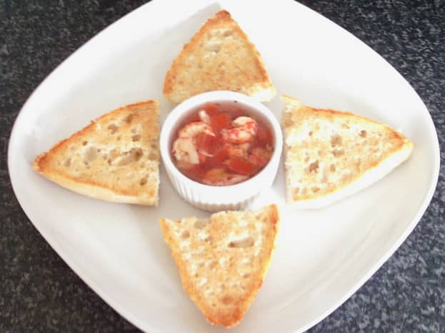 Tomato, basil and oregano potted crayfish tails with toasted cheesy bread rolls
