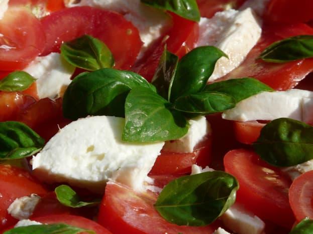Fresh tomatoes layered with mozzarella and fresh basil leaves