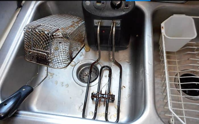 The immersion heater usually has a layer of brown slime that can be wiped off with a paper towel. The basket has a little bit more things embedded in the screen.