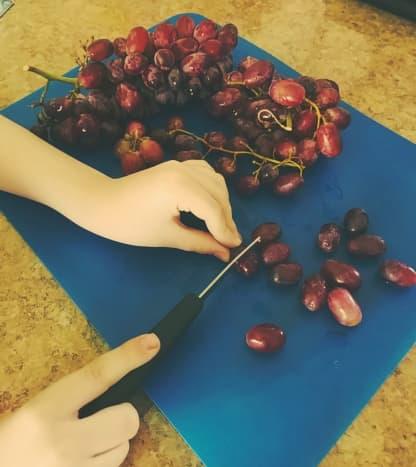Slice grapes in half.