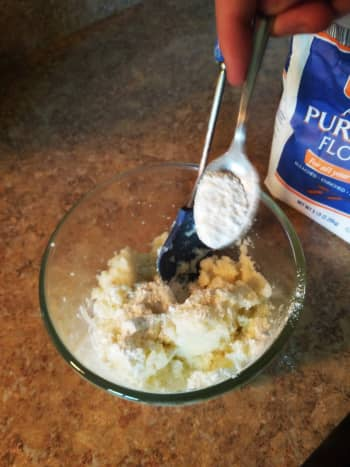 Add a pinch of salt, a pinch of pepper, and a teaspoon of flour to the leftover mashed potatoes. Mix well.