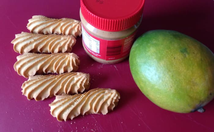 Some of the ingredients: biscuits, peanut butter, and a ripe mango.