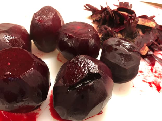 Peel your beets. If the skins don't fall off just gently peel with a vegetable peeler.