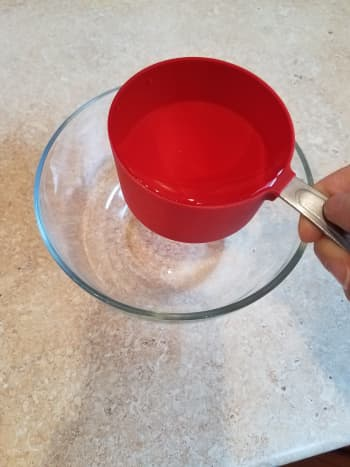 Start by adding 2 cups of warm water to a small bowl.