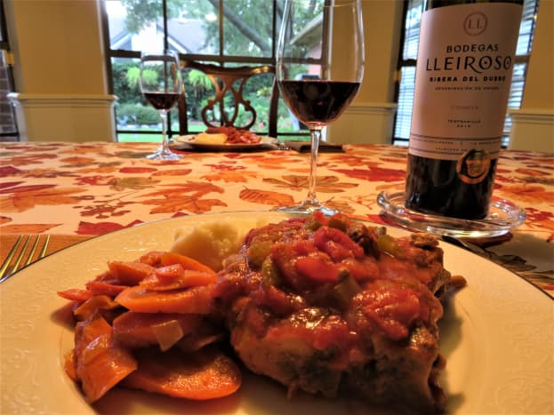 Here we are about to dine on the same dish except I have prepared it with pork chops instead of the country ribs.  A tempranillo wine varietal pairs well with it.