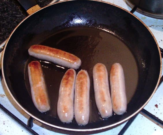 Frying sausages