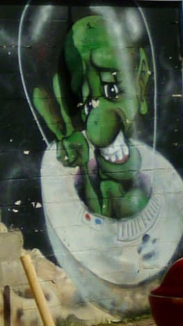 Green outer spaceman on the mural