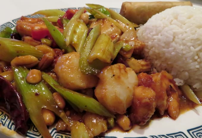 Shrimp and scallops with pepper sauce, steamed rice, and eggroll