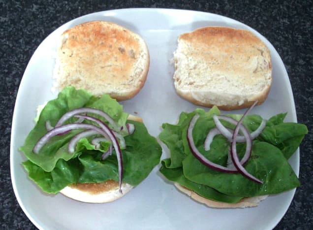 Lettuce and onion on toasted rolls