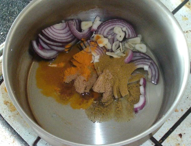 Sauteing onion and garlic with biryani spices