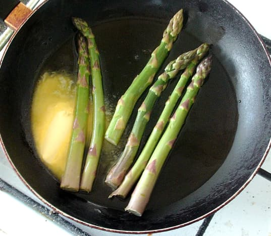 Asparagus is briefly sauteed in butter and oil