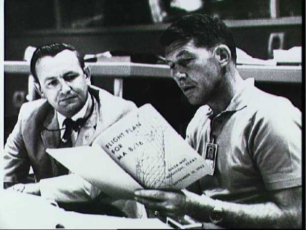 Wally Schirra reviews the flight plan for his mission. Photo courtesy of NASA.