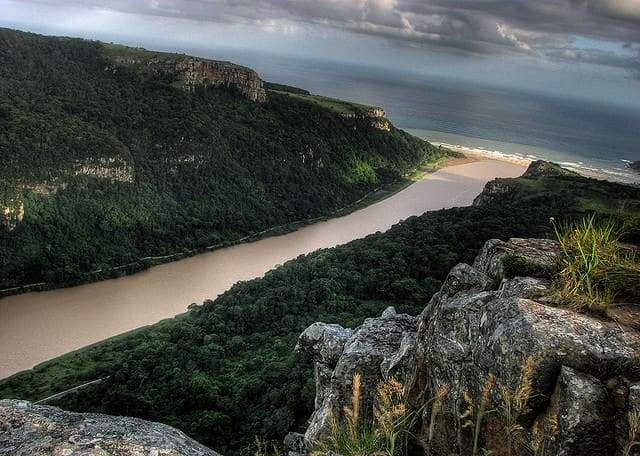 The Umzimvubu River carries silt to the ocean.