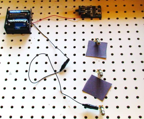 Attach a connecting wire from the negative terminal of the battery to the left side of the third bulb from the switch.
