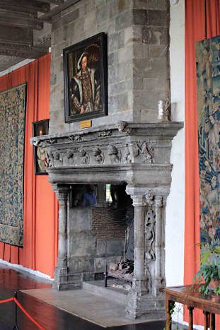 The 13th century 'Henry VIII Banqueting Hall'. The castle's largest room features this Tudor fireplace and a painting of the 'Field of the Cloth of Gold'