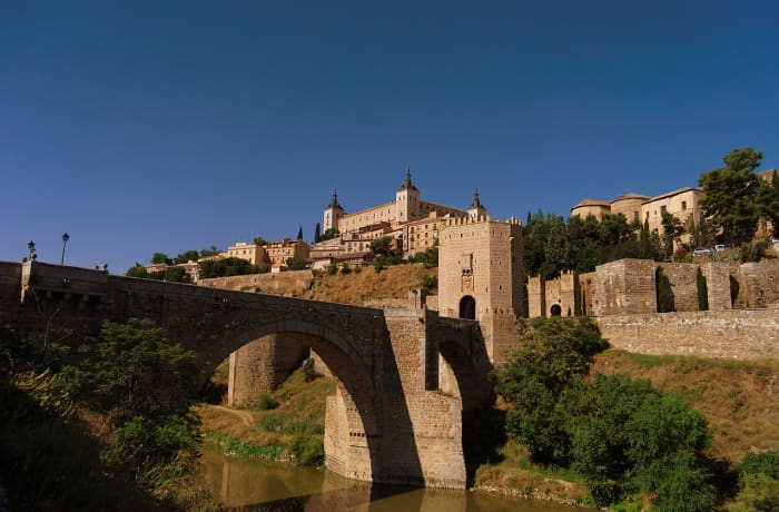 The Calced Carmelite monastery where Fray Juan had been imprisoned was destroyed during the Peninsular War (1807-1814). The retaining wall of the monastery is still visible just beyond the Alcántara Bridge.