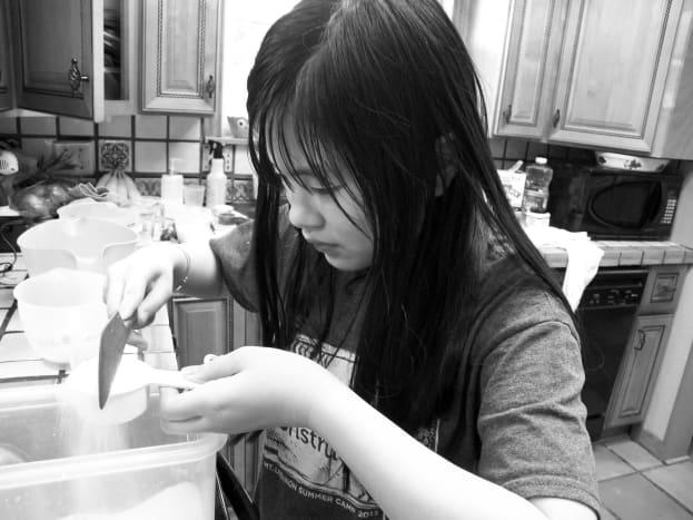Measuring ingredients for cupcakes.