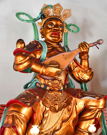 Chi Guo Tian Wang (The Eastern Heavenly King) with his magical pipa. The instrument/weapon is considered one of the most unique in Chinese legends, and was featured in the 2021 animated movie, Wish Dragon.