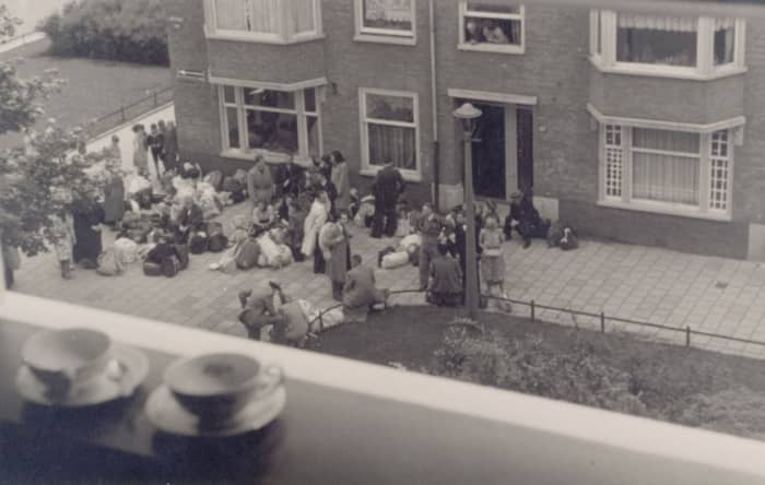 Neighbors watch from their windows as Jews are rounded up for deportation to killing centers.