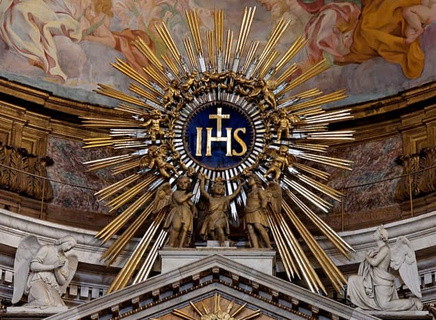 IHS monogram at the top of the main altar at Gesù in Rome, Italy.
