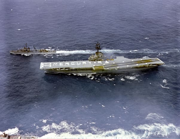 The crew of the U.S.S. Kearsarge spell out Mercury 9 on the ship's flight deck. Photo courtesy of NASA.