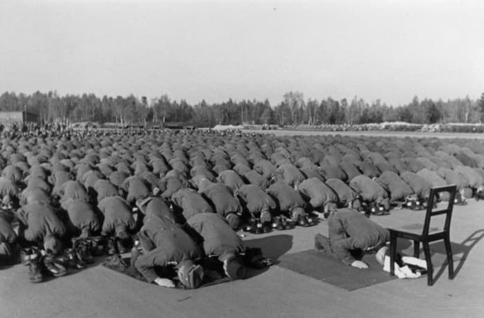 Muslim members of the 13th SS Division stop to pray.
