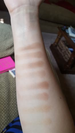 Finger swatches with brush swatches below each one. From top to bottom: Heaven (which you can't see on my skin tone), Satin Sheets, Nudie, Cashmere Bunny, Push-Up, and Honey Pot.