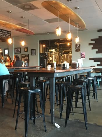 The center of the floor is filled with long high tables, while the windows and smaller cafe style tables, and there is a long bench with larger tables that are great for families. Of course, there are always plenty of stools at the bar.
