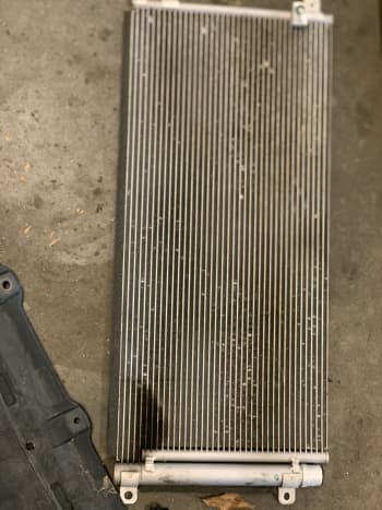 Oil spots on AC condenser cooling fins.